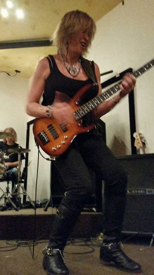 Givin' my new Carvin Xcellerator Bass Guitar a workout onstage