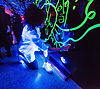 Shantell Martin is painting on a wall with neon colors