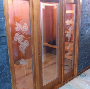 Beautiful Door installation for custom wine cellar