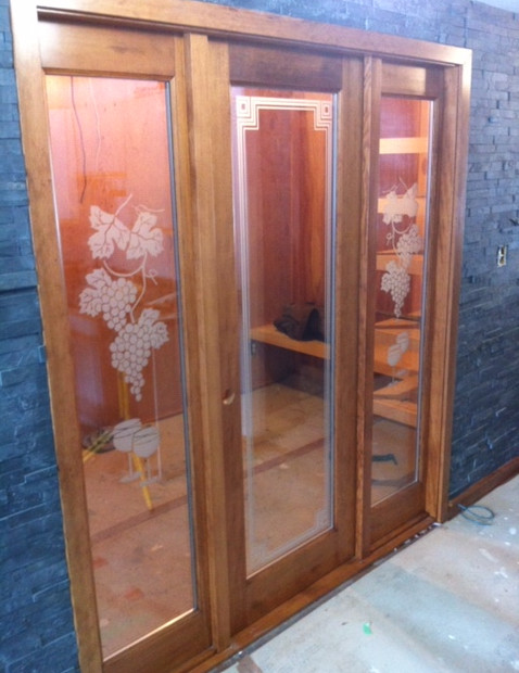 Beautiful Door installation for custom wine cellar