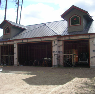 4 car garage with some detailed dormers.