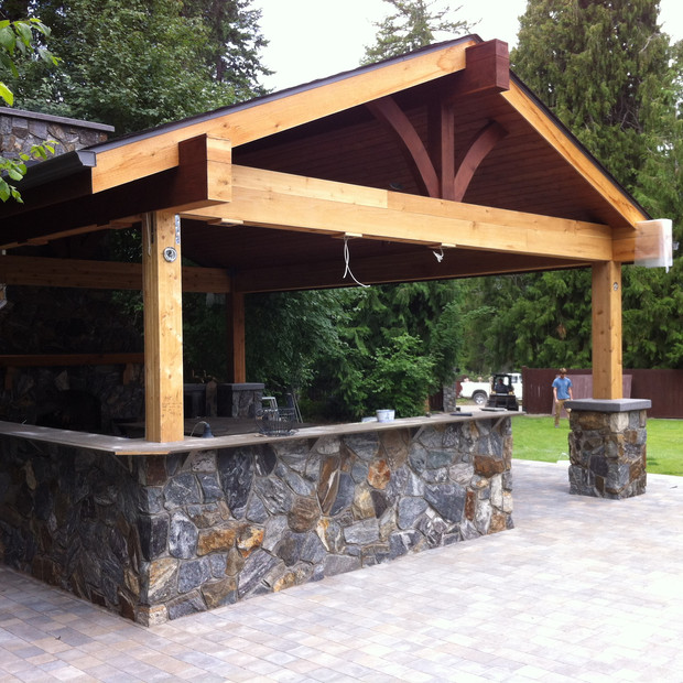 Beautiful Outdoor kitchen with stainless steal built in's and a large free standing fireplace