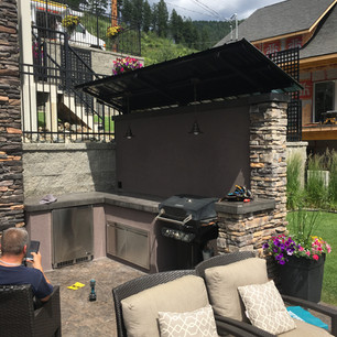 small outdoor kitchen, privacy wall/roof with a built ins and concrete countertop