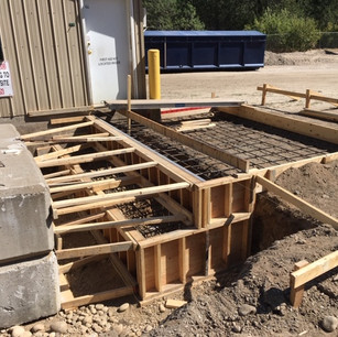 Commercial concrete bases for new weight scales at local land fills.