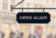 Open again sign board against open shop