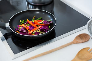 Canva - Food on a induction cooktop in k