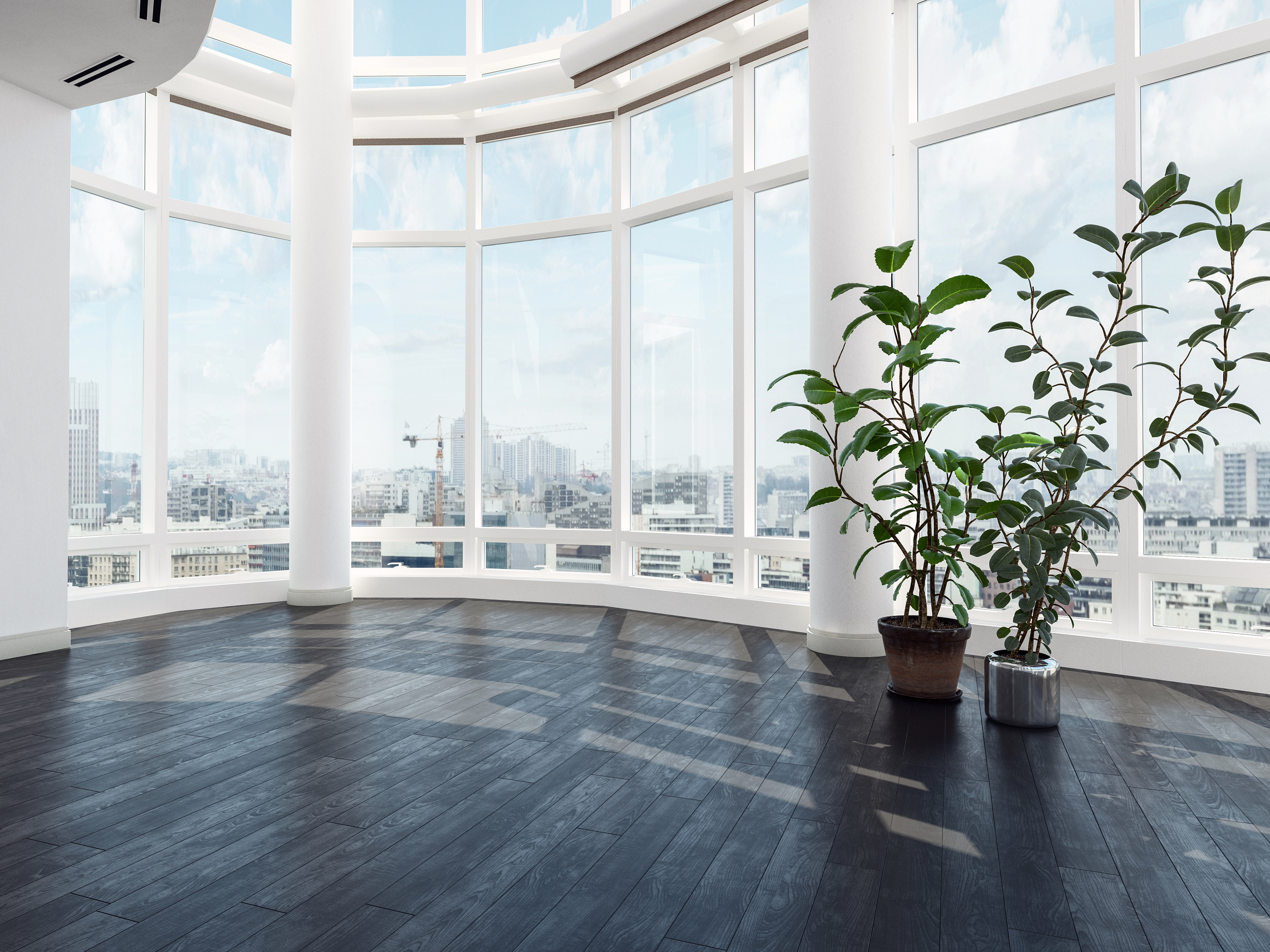 Empty vacant modern luxury apartment or penthouse interior with large curved view windows overlookin