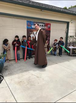 Male Jedi and Children Light Sabers