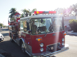 Marshall riding a fire truck