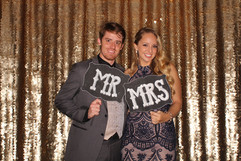 Wedding_photo_booth_with_gold_sequin_bac