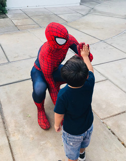 Spiderman giving high fives