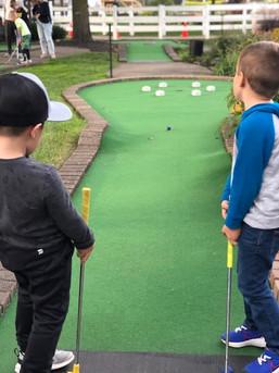 Edison and Evan Golfing.jpg