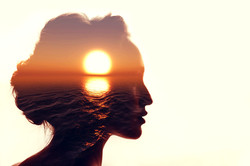 Psychology concept. Sunrise and woman si