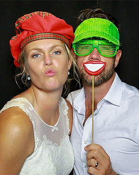 Wedding-photo-booth-hire-couple-blow-kis