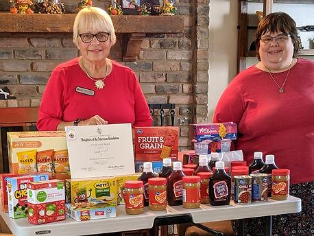 Tiff and Deb NEST Donations.jpg