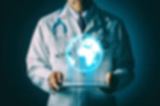 Man in white lab coat holding tablet wit