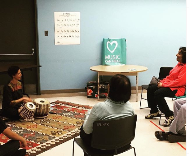 Anita Katakkar teaches North Indian tabla to Parkdale Library as party of Culture Week