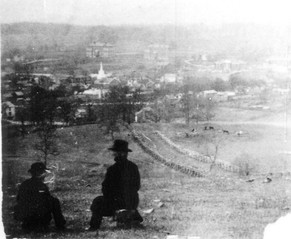 Two men looking over Blacksburg. (Pre 1888)