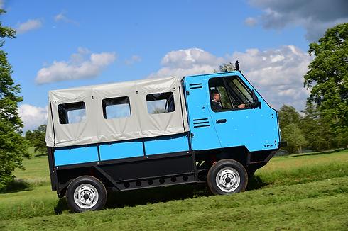 OX truck driving up a grass hill
