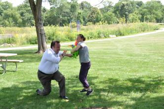 Mr. Wilson in a water fight