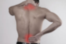 Close up of man rubbing his painful back