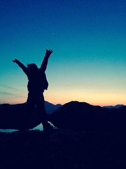 Silhouette in Sunset Cheering