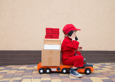 4-year-old boy in red overalls and a cap