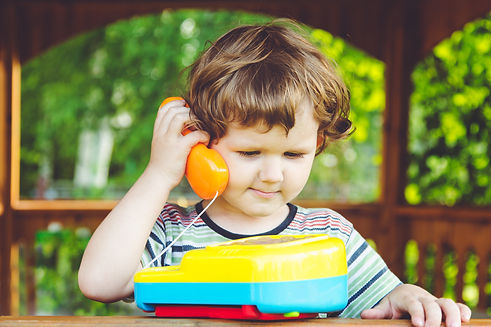 Little child talking on a toy phone..jpg