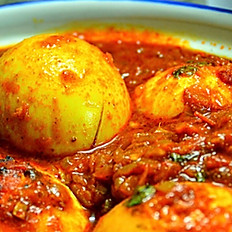 Egg Masala  served with Pilau Rice