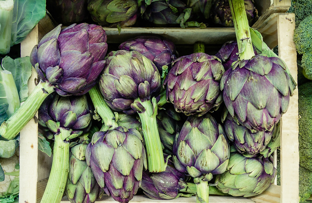 You can't bite into a raw artichoke, and you can't peel and eat it raw either (Photo by Martin Adams on Unsplash)