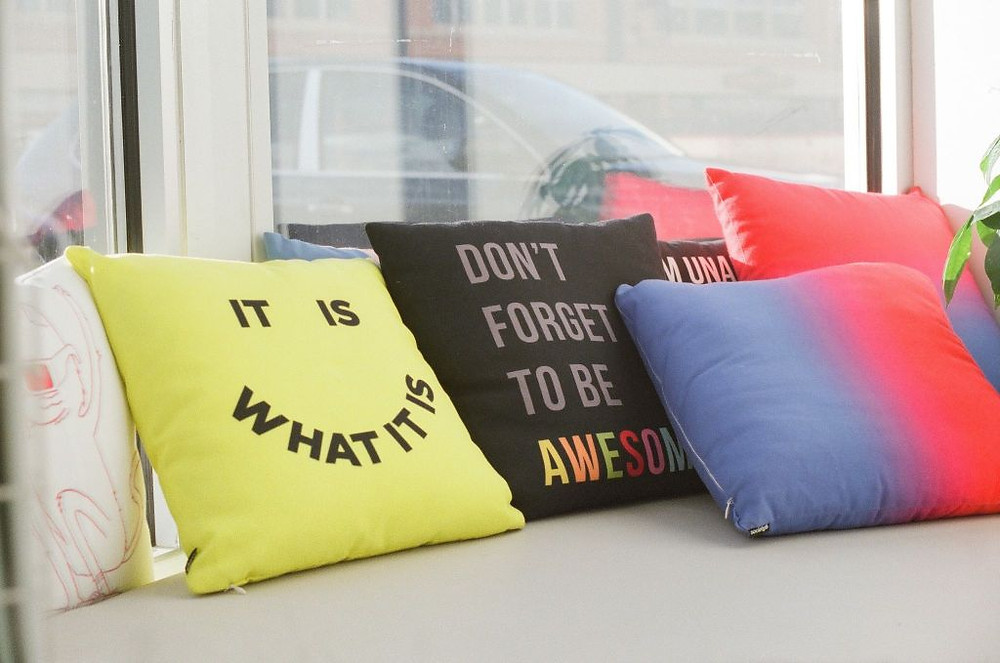 funny pillows in the window of a marketing firm office in lethbridge alberta