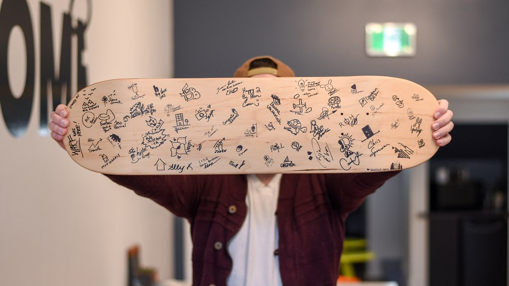 london road media skateboard as a guestbook at the marketing agency office