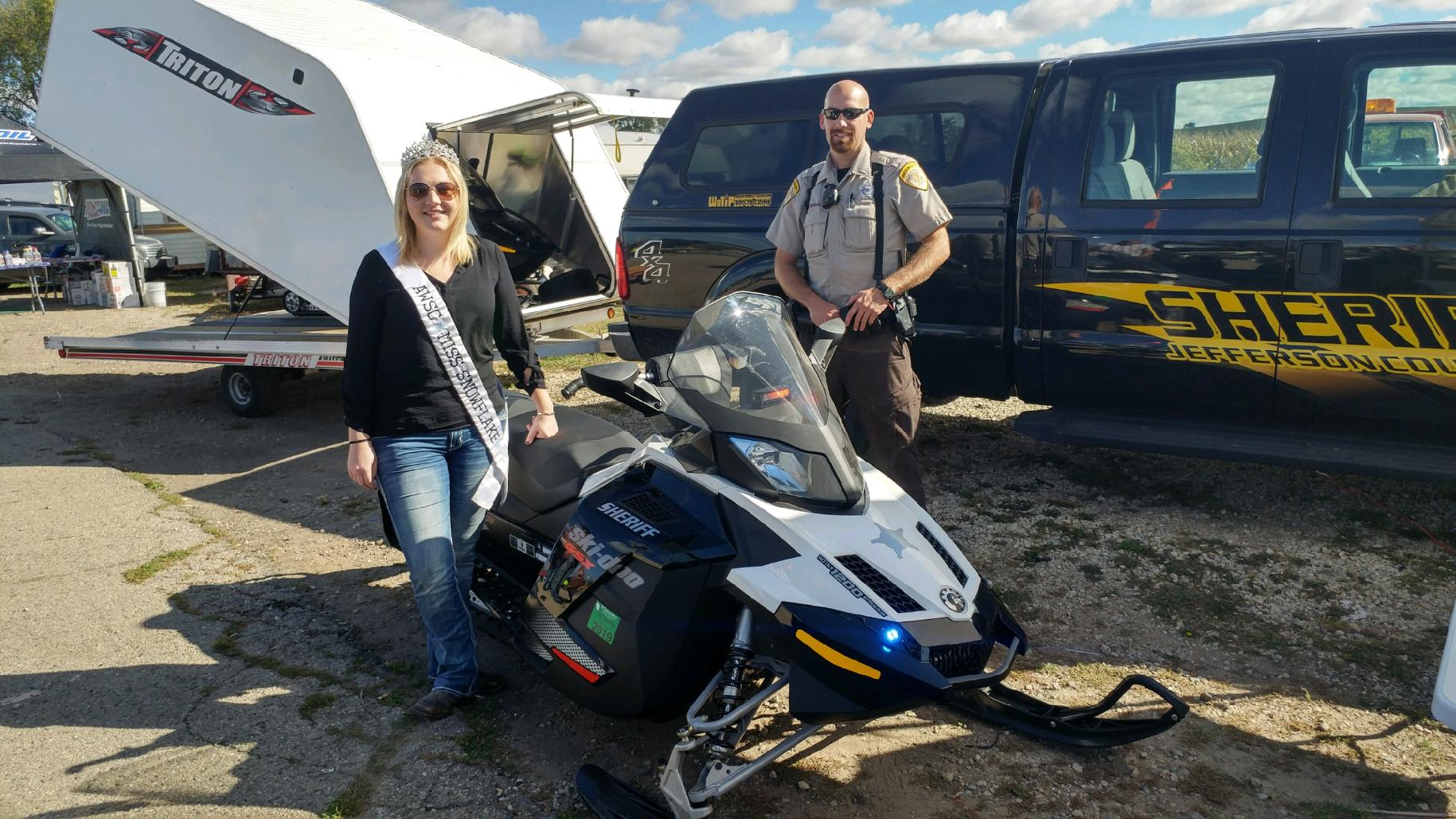 Miss Snowflake, Erica, and the county sheriff trail sled