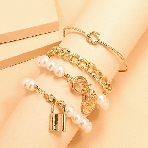 multi-layered gold and pearl bracelet-embossed coin charm