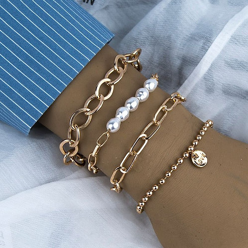 Gold and faux pearl love charm bracelet