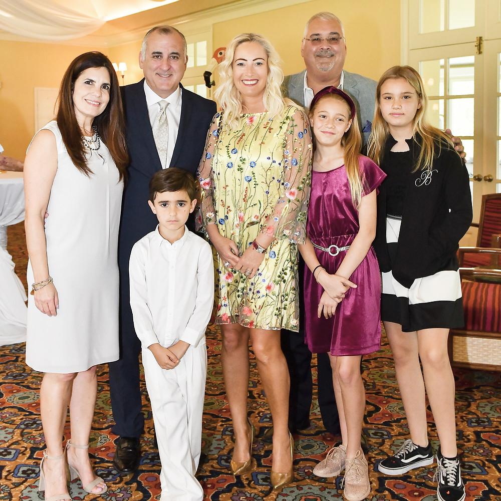 Viviana & Esteban L. Bovo @vbovo101 @commissionerbovo , Adina & John Brunetti Jr.. with kids at Alessandro Bovo Communion