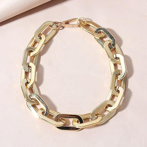 Acrylic gold finish choker linked chain design.