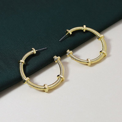 Gold nuts and bolts inspired hoop earrings