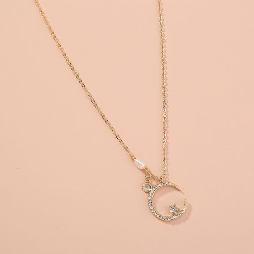 Gold alloy crescent moon with pearl