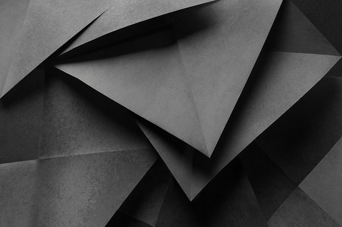 Macro image of paper folded in geometric shapes, three-dimensional effect, abstract backgr