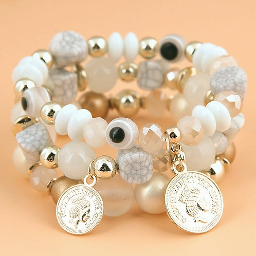 candy eye beaded bracelet gold white with gold charms.