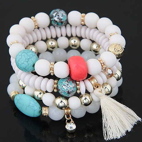 white base color four layer beads, with turquoise, gold and pink beads, with white tassel.
