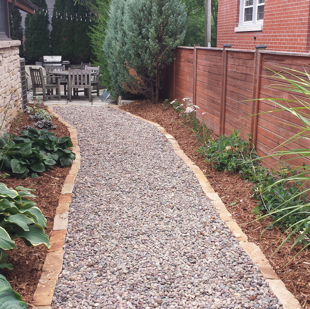 River rock path with border stone