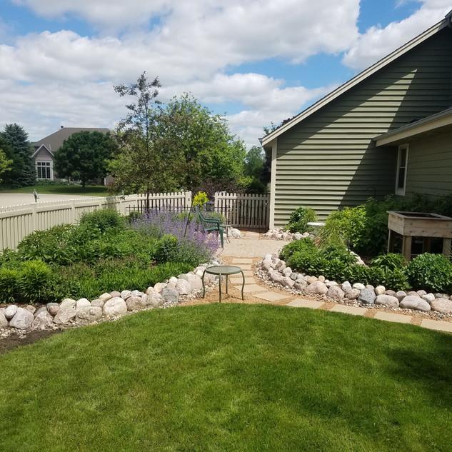 Backyard patio with butterfly garden