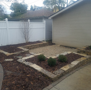 Lannon stone retaining walls with pea gravel sitting area