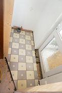 Floor tiling in down stairs toilet