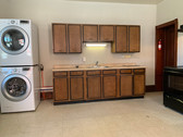 Kitchen with in unit washer and dryer.