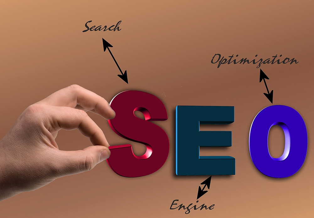 A hand picking at an SEO logo