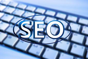 SEO logo against keyboard background