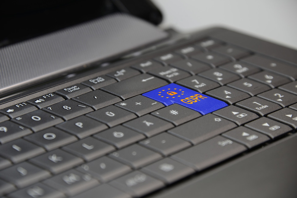 A laptop with a GDPR button on the keyboard